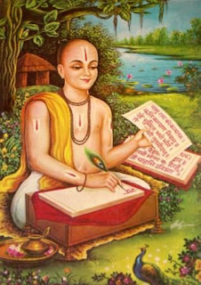 अवधी भाषा में रामायण (रामचरितमानस) की रचना करते हुए संत तुलसीदास जी