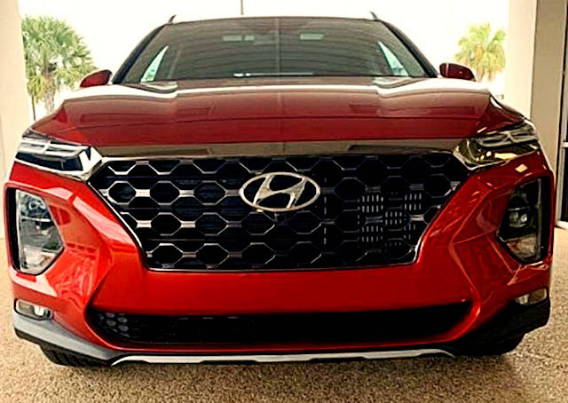 2020 Hyundai Santa Fe front exterior with grille, emblem, and headlights