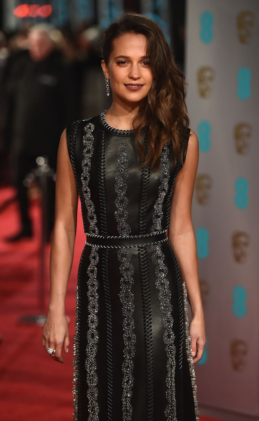 Alicia Vikander wears a leather dress to the BAFTAs 2016