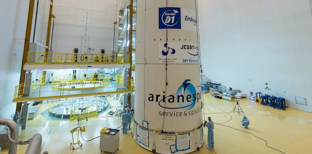Star One D1 and JCSAT-15 satellite being encapsulated in the payload fairing. Photo Credit: Arianespace.