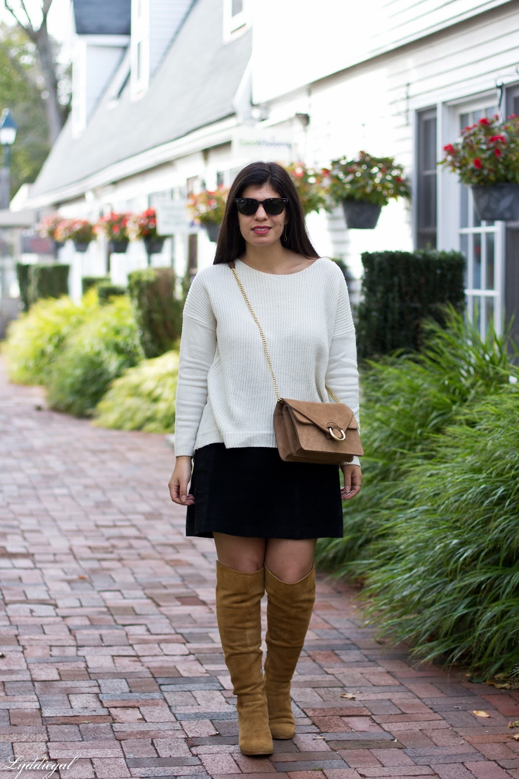 How to style over the knee boots with a skirt