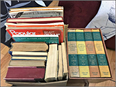 July 21, 2018 - At a yard sale lots of hard covered books for journals