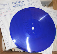 A blue-violet flexography and the case for an LP.