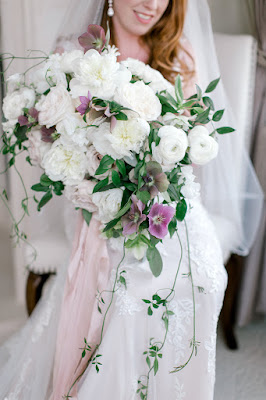 bride with overflowing wedding bouquet