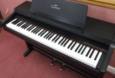 Nên mua đàn piano điện giá rẻ hay mua mới