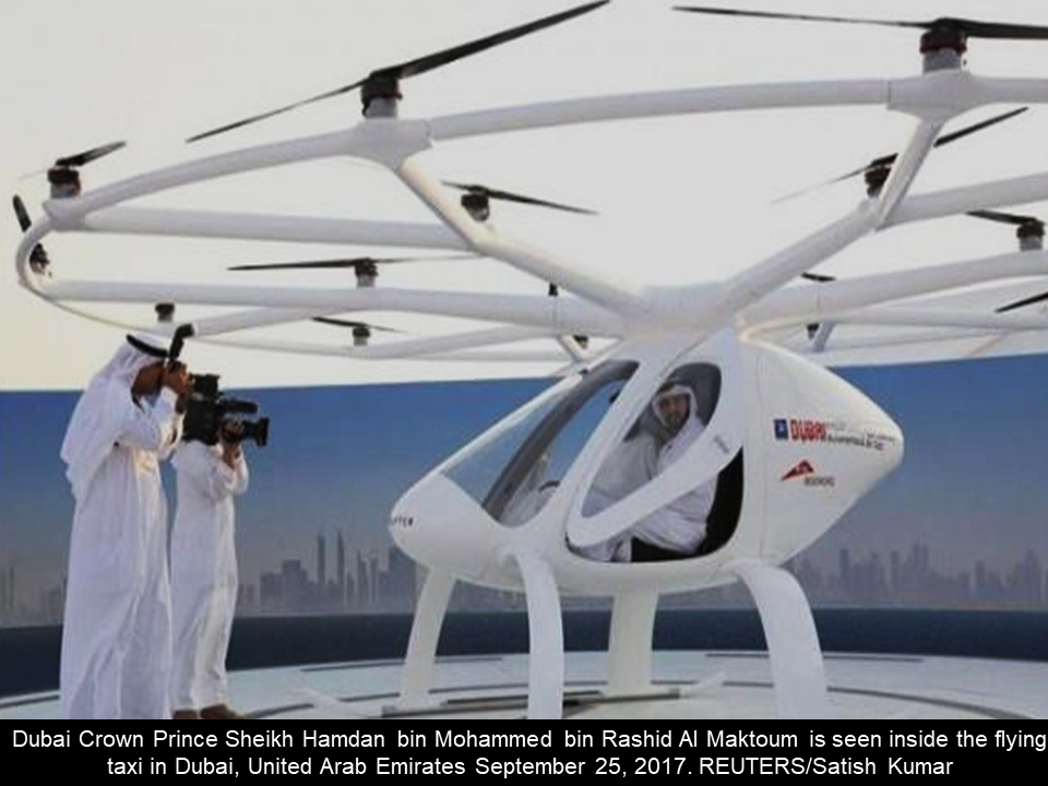 "A test flight of the possible first ever ""flying taxi"" has been made in Dubai, UAE. A huge drone that can carry  two people on flight is believed to be made  as new mode of transportation in the near future. Reuters report said that the huge drone  is similar to a two-seater  helicopter and it has 18 propellers. The drone made by a German company Volocopter is presently under rigid tests to assure the safety and reliability should it be made for transporting humans. The first unmanned flight of the flying taxi was made on Monday, with a distance of 200 meters and it was in the mid-air for 5 minutes. If the tests will be successful, the flying taxi is eyed to be launched in the next 5 years.    Sponsored Links   Meant to fly without remote control guidance and with a maximum flight duration of 30 minutes, it comes with plenty of fail-safes in case of trouble: back-up batteries, rotors and, for a worst case scenario, a couple of parachutes. Volocopter is in a race with more than a dozen well-funded European and U.S. firms, each with its own science fiction-inspired vision for creating a new form of urban transport that is a cross between a driverless electric car and a short-haul, vertical takeoff-and-landing aircraft. These include aerospace giant Airbus, which aims to put a self-piloting taxi in the air by 2020; Kitty Hawk, a company backed by Google co-founder Larry Page; and Uber, which is working with partners on its own flying taxi strategy.  ""Implementation would see you using your smartphone, having an app, and ordering a Volocopter to the next voloport near you. The volocopter would come and autonomously pick you up and take you to your destination,"" CEO Florian Reuter said.   ""It already is capable of flying based on GPS tracks today, and we will implement full sense capability, also dealing with unknown obstacles on the way,"" he added, saying developers aimed to initiate the taxis within five years.   In Monday's test flight, the device hovered upward about 200 meters and whirred for about five minutes over a windswept patch of sand astride the emirate's Gulf coast.   Attired in crisp white robes and headdresses, Sheikh Hamdan and his entourage clapped approvingly from a nearby viewing deck as the craft alighted.   The UAE has sought to distinguish itself in a region mired in war and strife as a high-tech, forward-looking society.   It plans to send an unmanned probe to Mars by 2021, the Arab world's first mission to space, and Dubai has in many ways led their showy march into the future by introducing the region's first driverless metro and robot policemen prototypes.   ""Encouraging innovation and adopting the latest technologies contributes not only to the country's development but also builds bridges into the future,"" Sheikh Hamdan said in a statement. Sources: Reuters, GMA News"