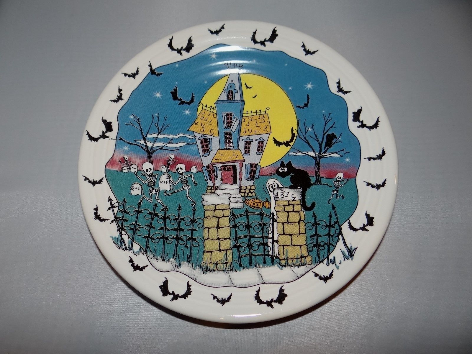 add an extra festive touch to your next halloween celebration with these decorative plates from fiestaware the dancing skeletons and whimsical bats on this