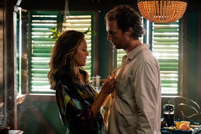 Movie still for Steven Knight's film Serenity where Diane Lane unbutton's Matthew McConaughey's shirt