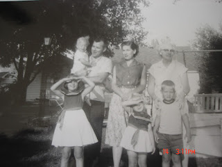 A photo of a black and white picture of a mother and father with four children and a grandmother | Play time manners