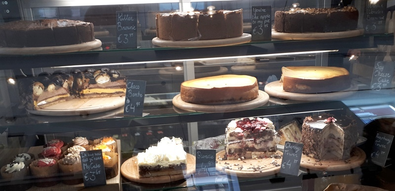 slices Cakes cheesecake brownie muffins glass display case Chocolate Company Cafe Rotterdam Oude Binnenweg Netherlands