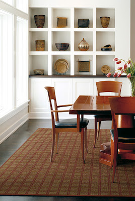 Patterned area rug adds comfort and style to this dining room