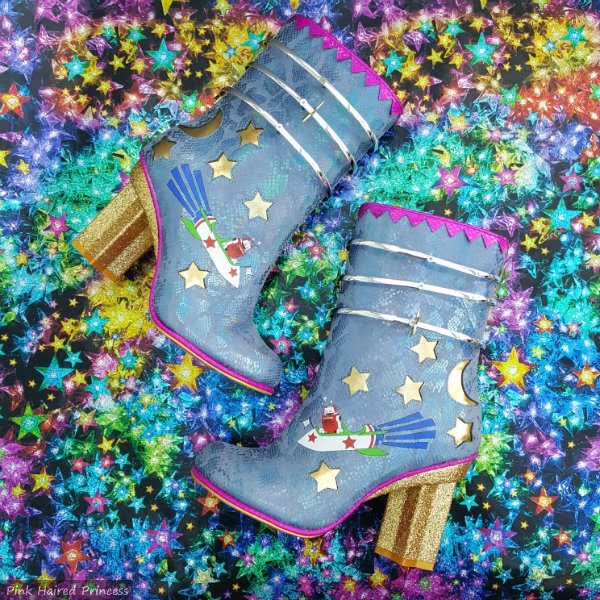 blue robot boots with silver rings on dazzling star background