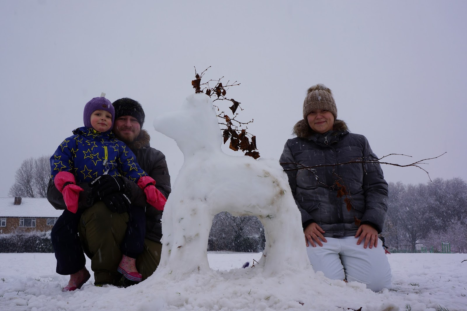 family and snow pony