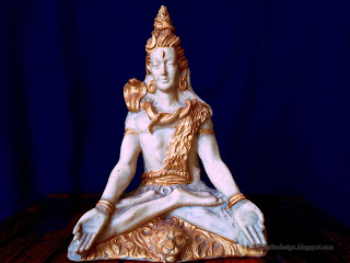 lord Shiva Mini Statue On The Table With Blue Background