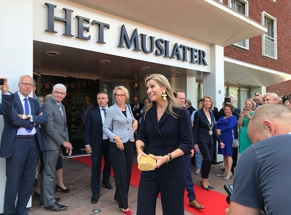Queen Maxima wore Natan Crepe Jumpsuit, Natan gold earrings, and she carried Natan clutch bag for More music in the classroom' meeting