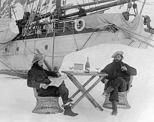 French Antarctica expeditionist J.B. Charcot (left) and Raymond Rallier du Baty drinking Mumm Champagne in Antarctica, Bastille Day 1904