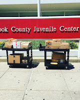 boxes of books to be donated to Cook County Juvenile Center