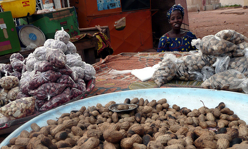 Selling nuts at an African market by qtea