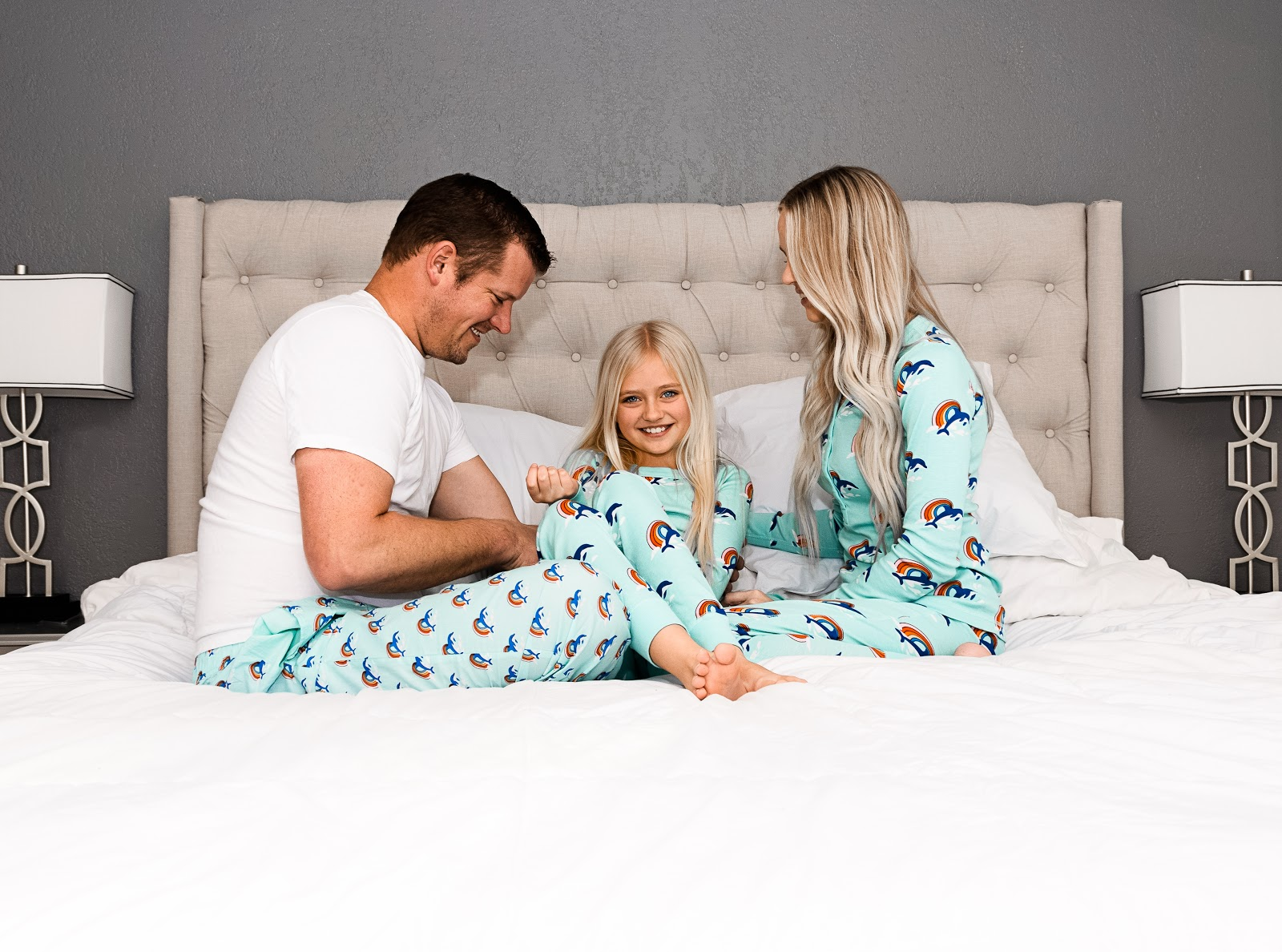 Fun Family Pajamas in the Spring!  matching twinning jams pjs footie pajamas family time matching family pajamas love bedroom bed photoshoot family photoshoot idea pajamas