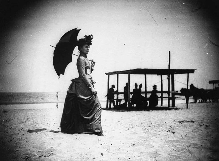 Vintage Photo. Woman at the beach with long skirt, hat and umbrella c.1900s. Manners, A Word to Women by Mrs. C. E. Humphry, 1898. marchmatron.com