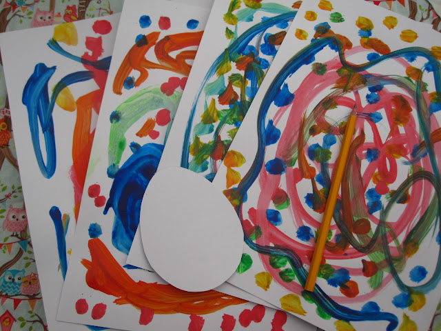 Four dry paintings with an card egg template and a pencil