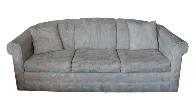 A light-toned sofa in floral fabric with a later 1980s, early 1990s style. Simple design but not very interesting.