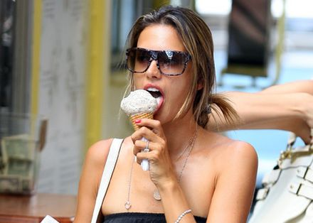 Young girls lick ice cream