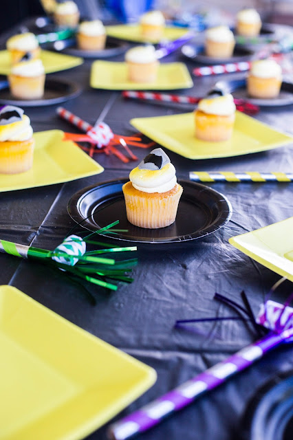yellow cupcakes with batman sign