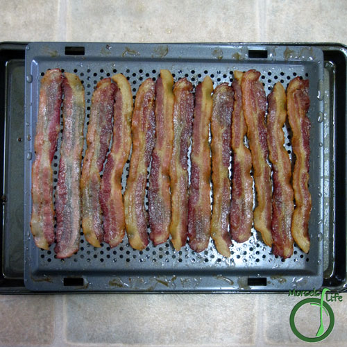 Morsels of Life - Crispy Bacon Strips Step 3 - Bake at 275F until crispy. Flip partway through if desired.