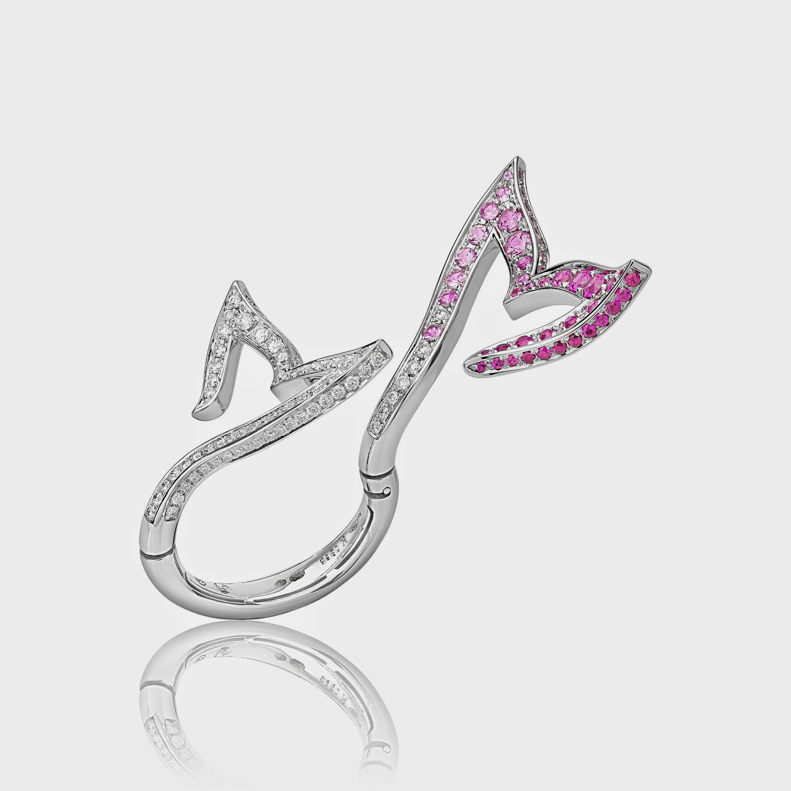 4cd486d1a8a The flexible Mermaid Tail ring from the Beauty of the Sea Collection has white  diamonds and pink sapphires set in 18k white gold.