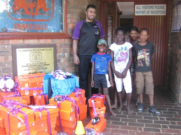 Hollywoodbets Daxina with donations of new soccer boots and sports equipment for the children of SOS Enerdale