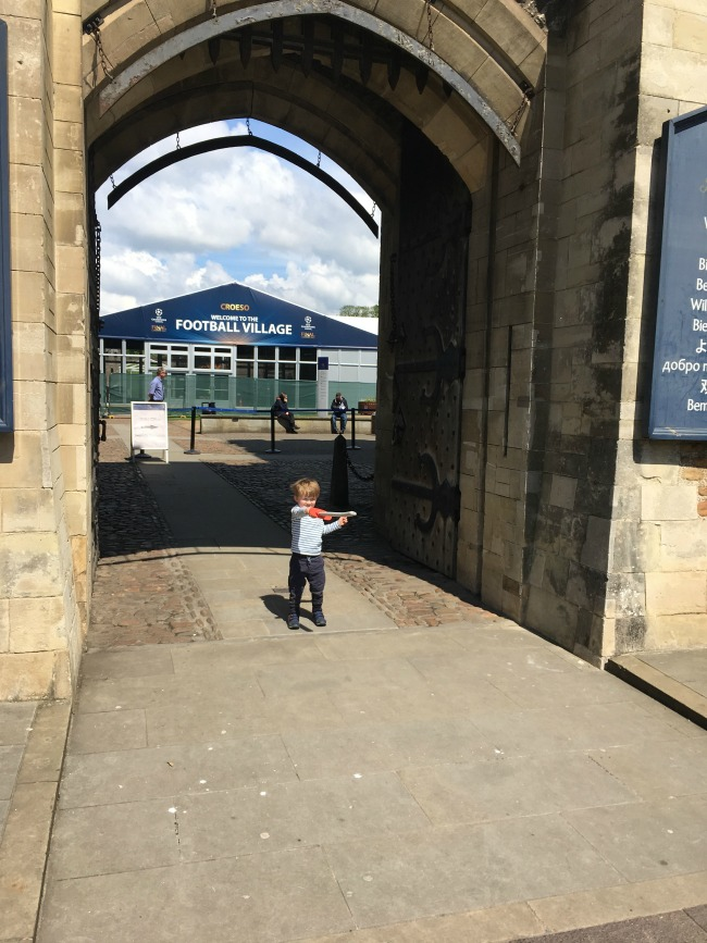 cardiff-castle-with-a-toddler-holding-a-toy-sword