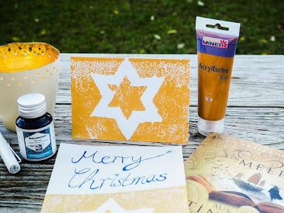 ein-meer-aus-tinte-und-gold-weihnachtskarte-buch