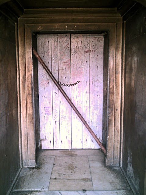 plain locked wooden door at the Agra Fort