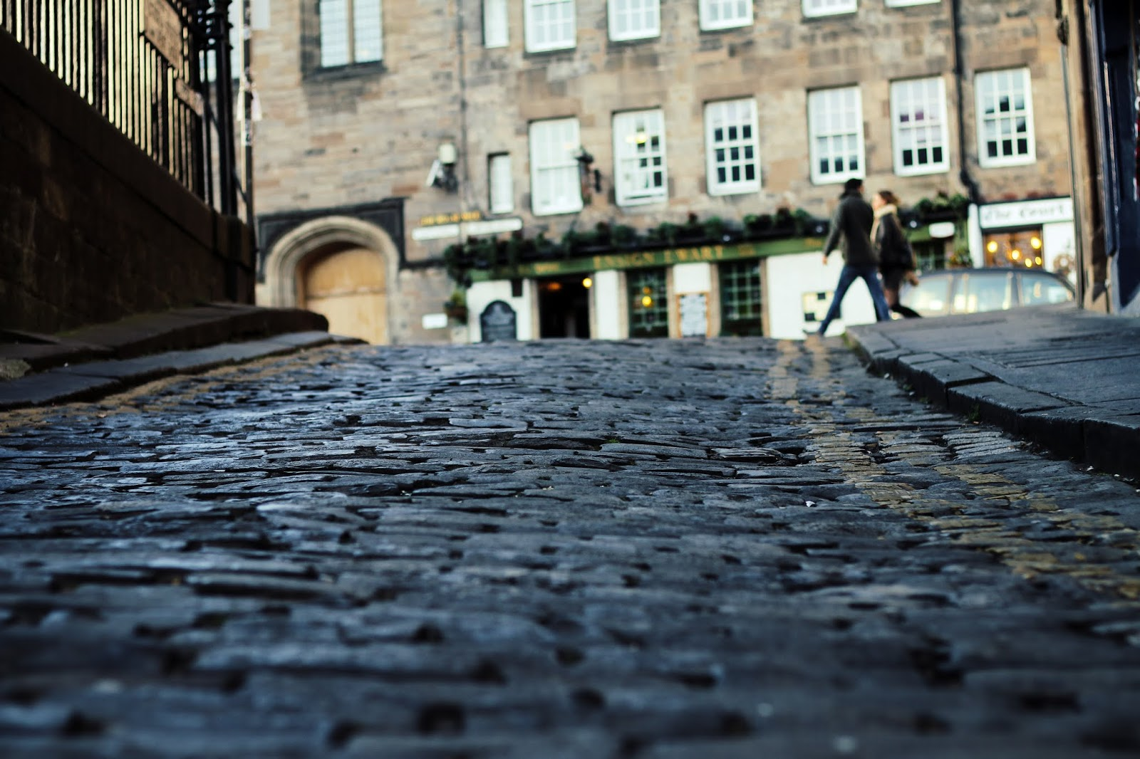a close up of some cobble stones in Edinburgh on the street of the royal mile