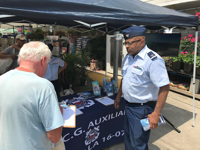 Auxiliarist David Witherspoon spoke to potential members to recruit to join the US Coast Guard Auxiliary