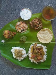 Ponni rice, Dhal, Brinjal Drumstick Sambar,  Potato masala, Cabbage Carrot poriyal,  Ladies finger Chickpeas mandi,  Coriander chutney, Rasam, Curd, Pappad
