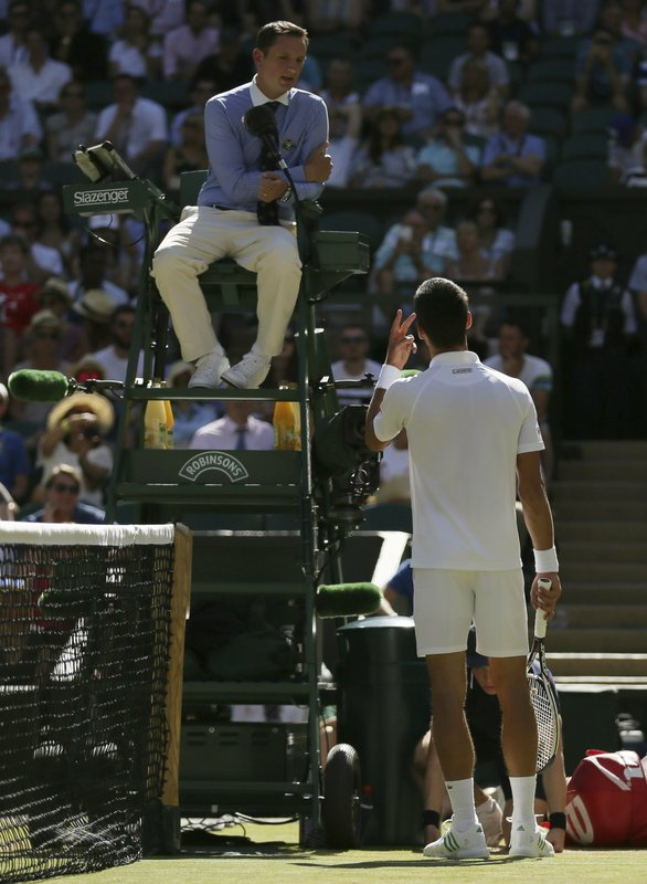 Novak Djokovic gestures to umpire Jake Garner as he disputes a call in his Men's Singles Match