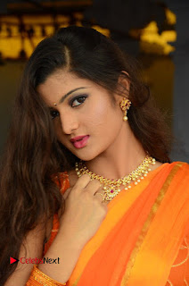 Akishitha Poojitha Menon super cute sensual in chiffon orange Saree sleeveless Choli at Prayanam Opening