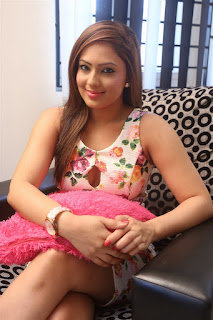 Nikesha Patel Stills in Floral Short Dress at Narathan Movie Interview ~ Celebs Next