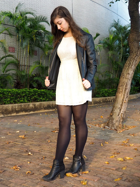 Night & Day | outfit of lacy white dress, black leather jacket, with black tights and heeled ankle boots