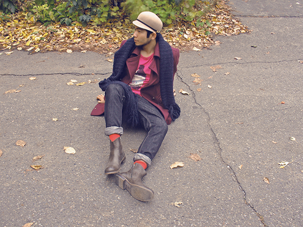 Man in Burgundy coat and eggplant blue giant knit scarf, with beige wool hat