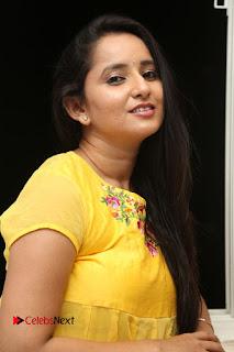 Actress Ishika Singh Pictures in Yellow Dress at Kobbari Matta Teaser Launch  0030.JPG