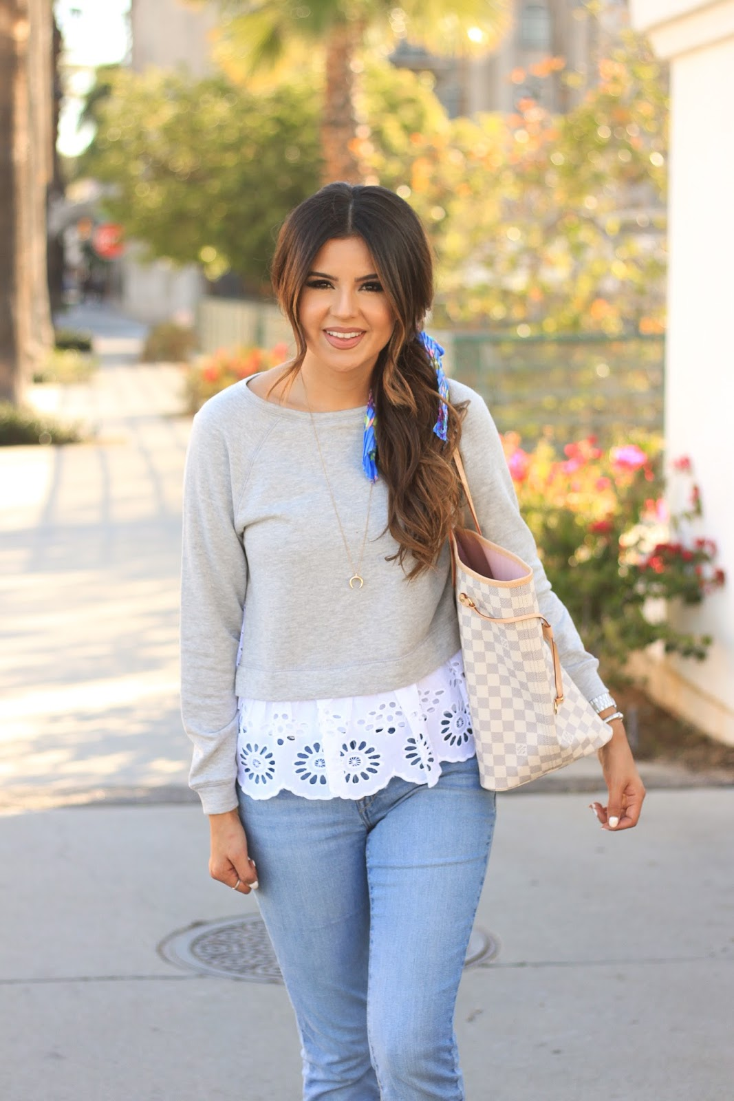 How to dress up a eyelet sweatshirt with a floral hair scarf and crescent pendant necklace