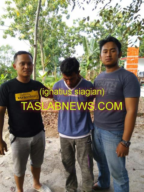 Tersangka Irwansyah alias Irwan (42) saat diamankan petugas Tim Operasional Antik Toba 2018 dari Satres Narkoba Polres Tanjungbalai, Kamis (30/8).