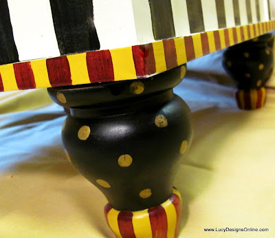 hand painted stripes and dots dog bed with carved wooden feet