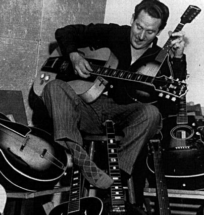 Foto de Les Paul con muchas guitarras