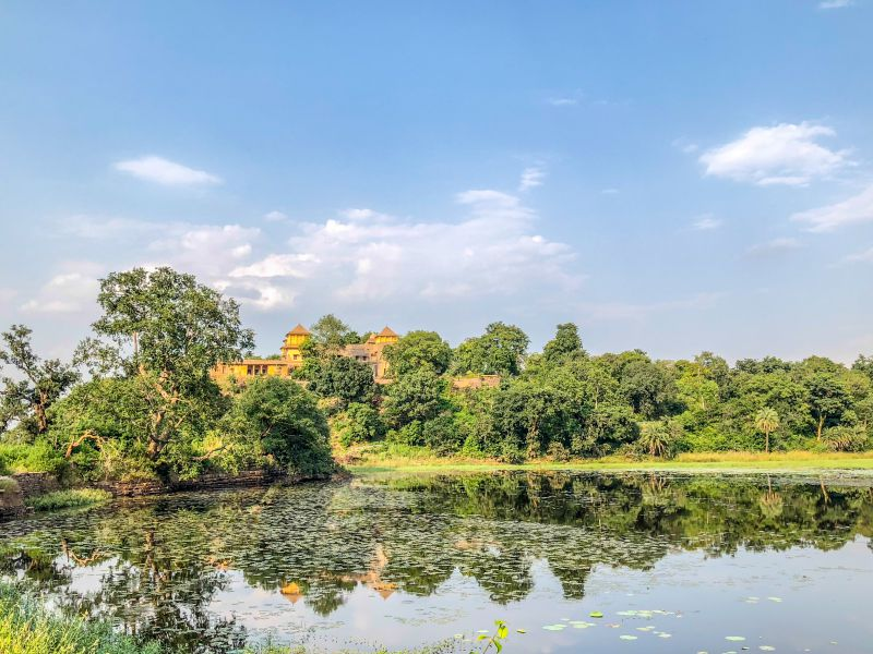 Singhpur Palace with a beautiful Lotus pond in front of it