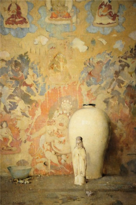 Magnificent colorful still life painting with saint statue and colorful wall by Emil Carlsen Soren