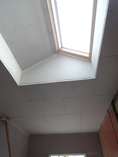 plasterboard around roof window in flat ceiling